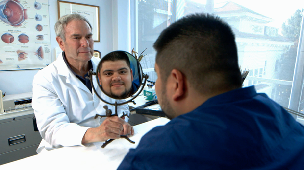 Fred Harwin and patient Arturo Lucatero with his new ocular prosthetic.