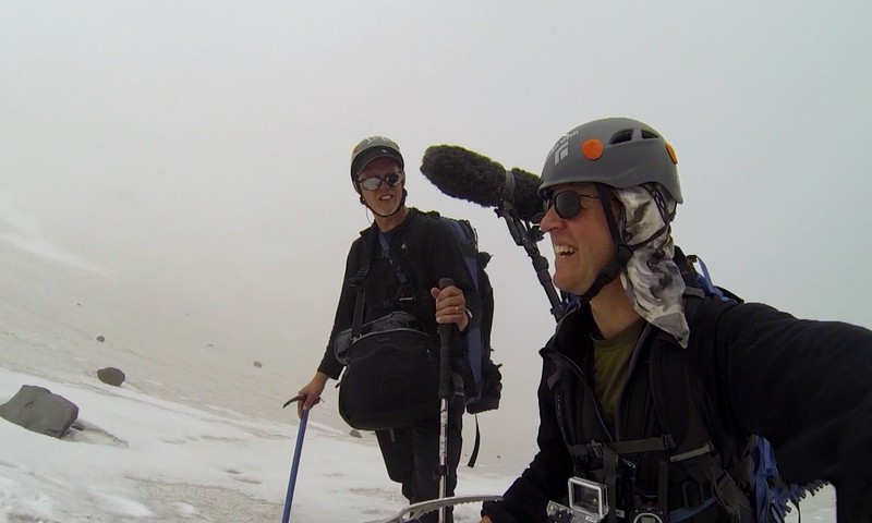 Producer Ed Jahn and Senior Videographer Todd Sonflieth filming Mt St. Helens Glacier Caves in treacherous conditions