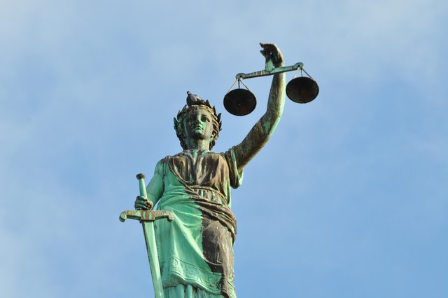 A statue of Lady Justice sits outside a courthouse in the U.S.