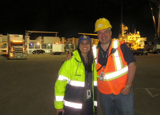 Port of Olympia Marine Terminal Director Len Faucher and Communications, Marketing and Outreach Manger Jennie Foglia-Jones pose Thursday night in front of Angus Express during loading.
