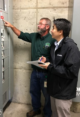 Coquille Valley Hospital plant operations director Ernie Fegles, left, and Andreas Winardi of Siemens discussed how a microgrid might work during a site visit on Sept. 27.