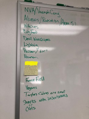 A whiteboard list tracks the theories called in to the Harney County Sheriff's Office. Few clues have led to a lot of spectualion and guesses on how several bulls were mysteriously cut down this summer. Note: The image has been edited to obscure personal information of someone who had called the sheriff's office.