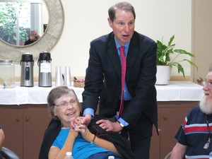 Democratic Sen. Ron Wyden talks to residents of Laurelhurst Village Assisted Living in Portland about cuts in the new Republican health care bill.