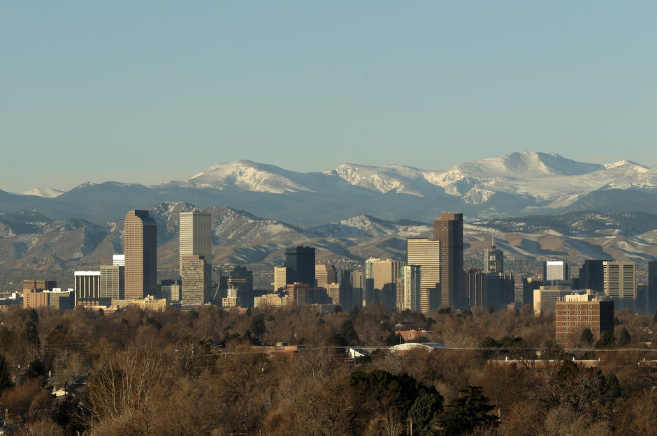 The Rocky Mountains are seen behind the Denver skyline in 2016. Bidding wars over houses have become the norm in many cities, including Denver.