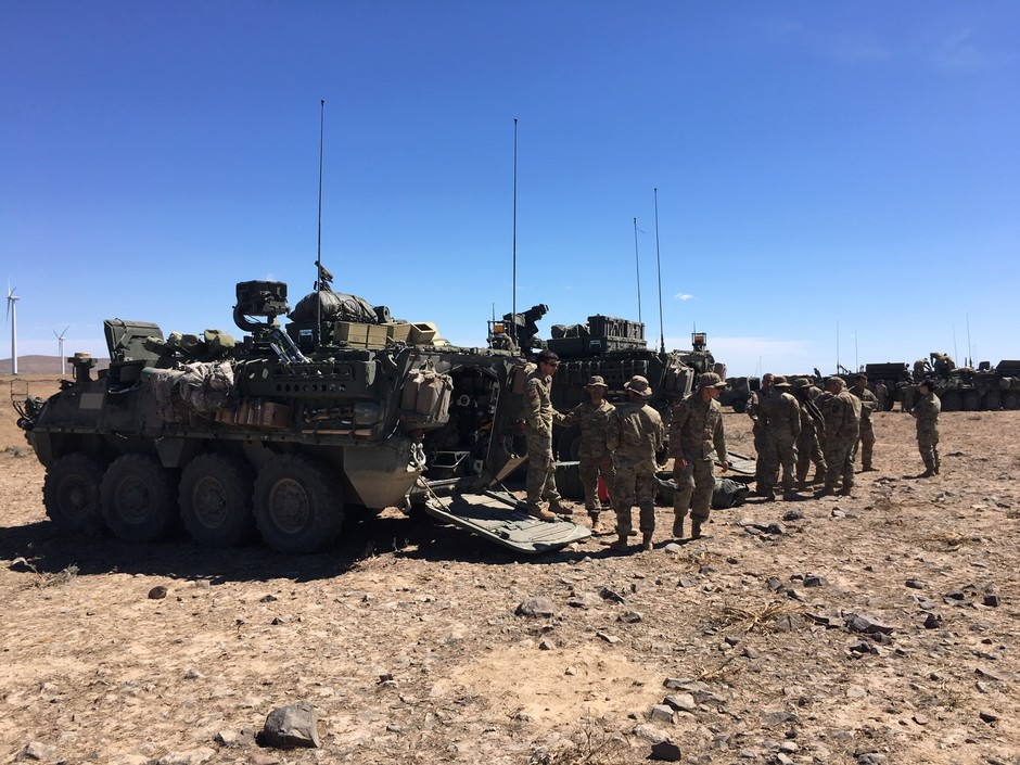 Members of the Washington Army National Guard's 81st Combat Brigade with their Stryker vehicles at the Yakima Training Ground.