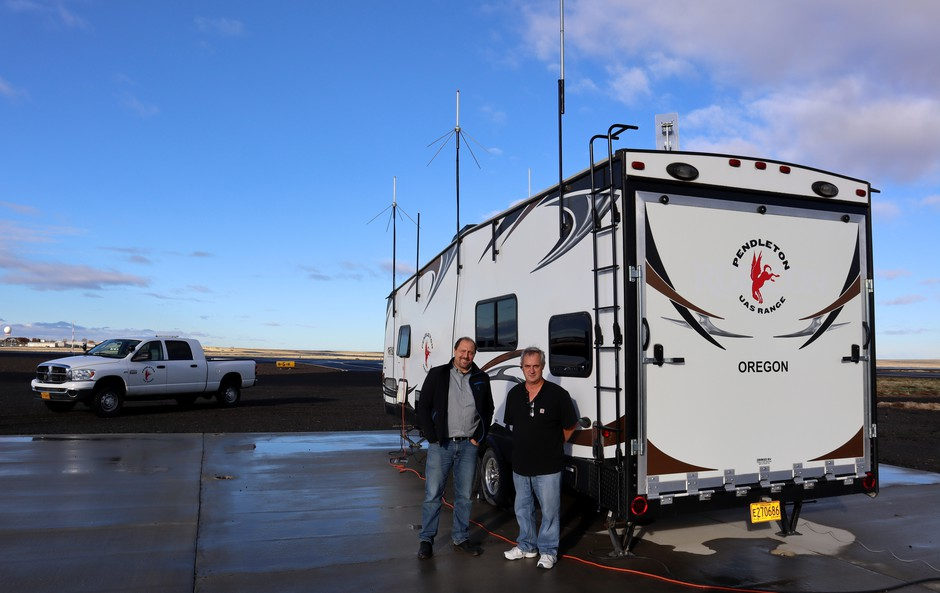 Pendleton UAS range manager Darryl Abling and airport manager Steve Chrisman next to their mobile mission control RV.