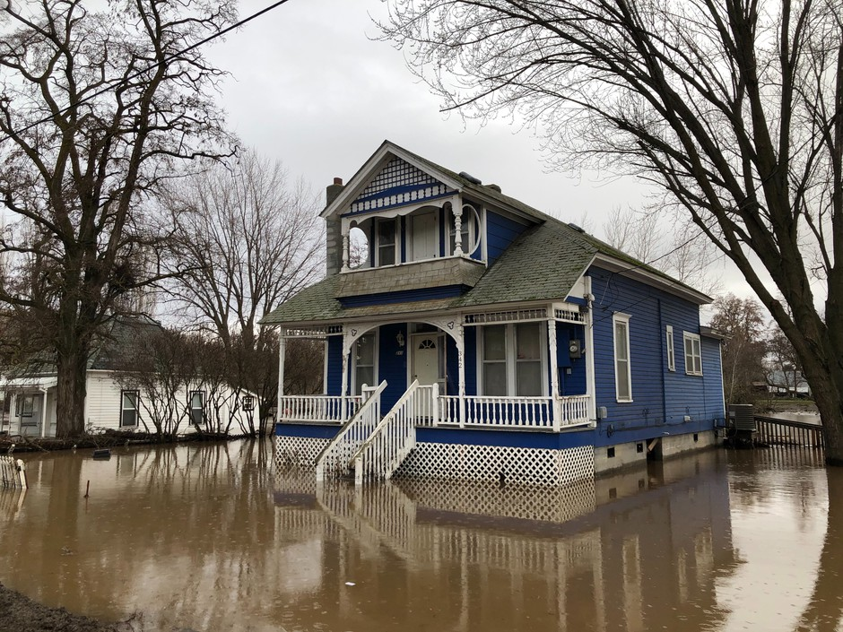 Many houses in Waitsburg, Washington, a small wheat town, are still sitting in lakes of trapped water. Residents were busy moving out their valuables, and accessing damage on Saturday, Feb. 8, 2020.