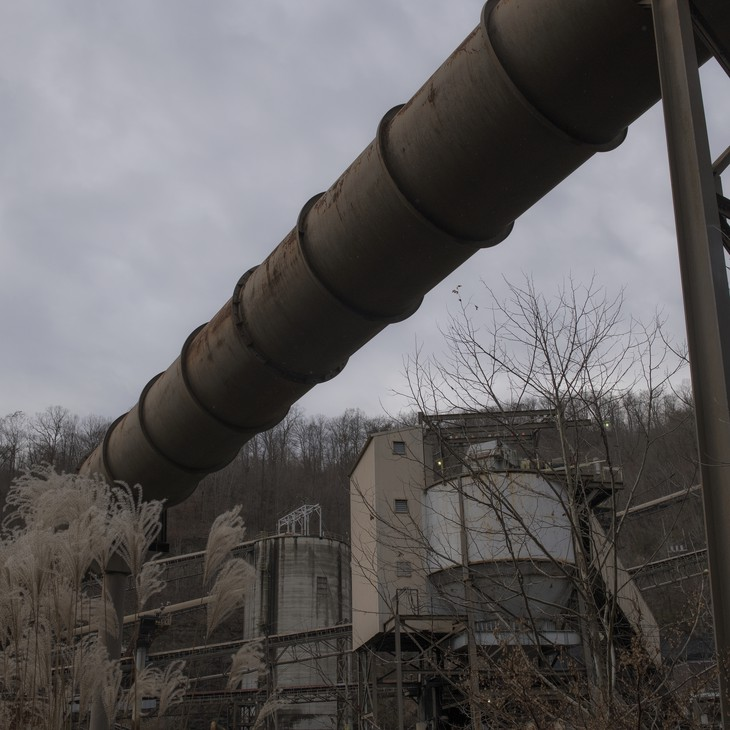 A coal processing plant sits abandoned near Smith's home in Pike County.