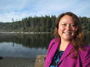 Fawn Sharp, tribal council president of the Quinault Indian Nation, has participated in international climate negotiations in the past but she says this year in Paris she's eager to see where the conversation goes but won't be signing any international climate deals.