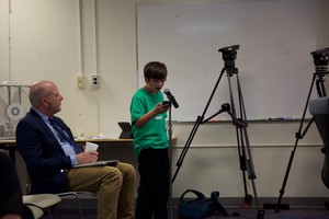 ACCESS Academy fourth-grader Kirin Cowell-Shah questioned the wisdom of splitting up his school into two locations. Portland Public Schools director of strategic communications and outreach, Harry Esteve, looks on.