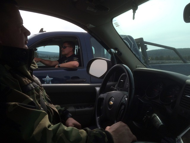 Oregon State Fish and Wildlife troopers James Hayes, left, and Darin Bean patrol several thousand square miles in central Oregon, where mule deer are in decline.