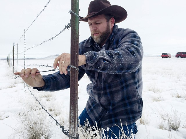 Ammon Bundy at a stretch of fence at the Malheur National Wildlife Refuge Monday, Jan. 11. The armed occupiers of the refuge took down an 80-foot stretch of the fence to open up the lands to cattle from a nearby ranch.