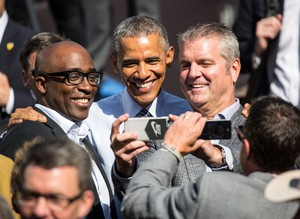 President Barack Obama takes a selfie with community members after discussing the Trans-Pacific partnership agreement at Nike's world headquarters on May 8, 2015.