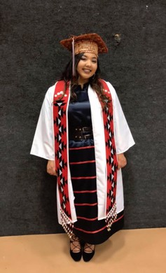 "SuSun Fisher in cap and gown as she graduated from Chemawa Indian School in 2017. The former ""Miss Chemawa"" is in her first year at University of New Mexico."