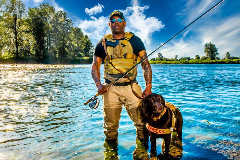 Chad Brownwith his dog Axe on theWillamette River, Oregon.