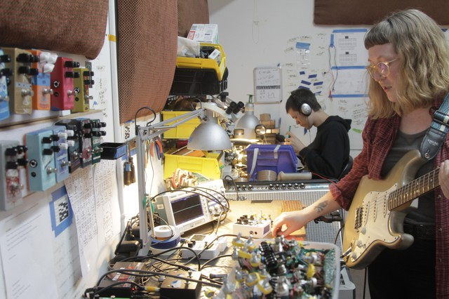 Anna Ridenour in the QC room at effects pedal maker Catalinbread.