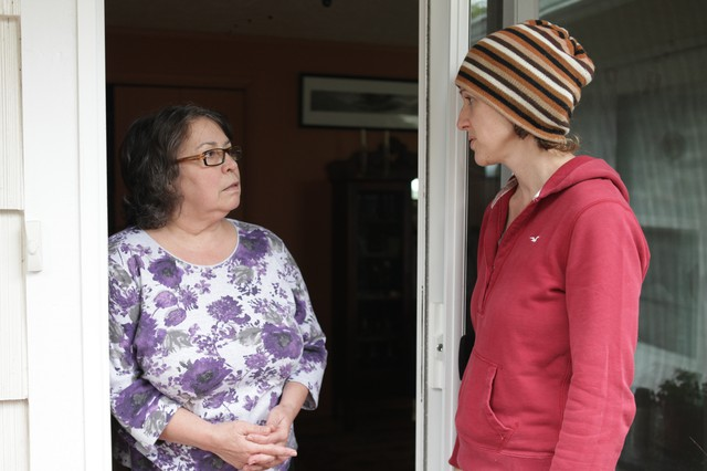 Krista Eddy, right, speaks with Laura Quilman about her emergency preparedness plans.