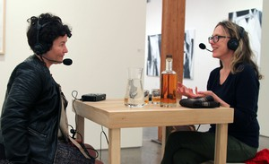 """Artist MK Guth (right) explains her work and raises a glass with April Baer at her installation """"Instructions for Drinking with a Friend."""""""