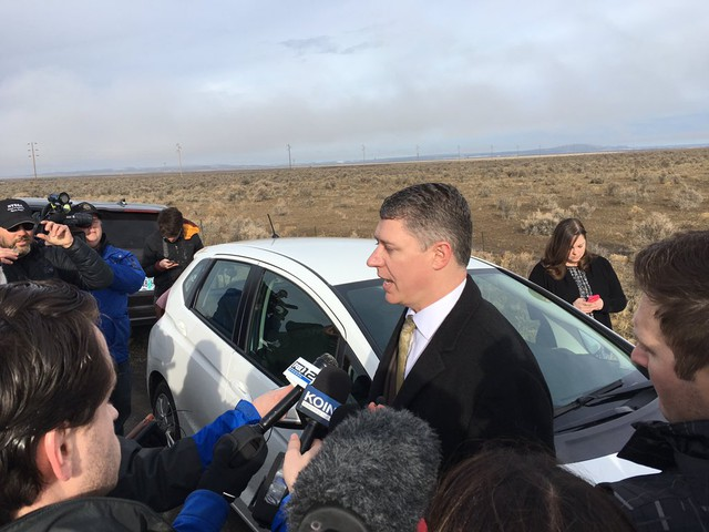Ammon Bundy's attorney Mike Arnold speaks with the media before the occupation ended in February.