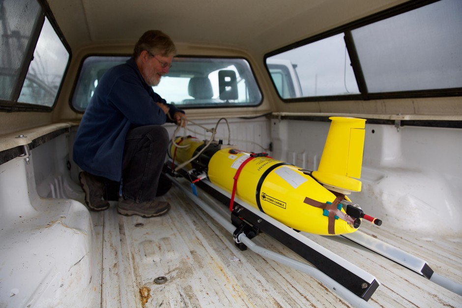 Scientists carefully carry the glider out to the research vessel.