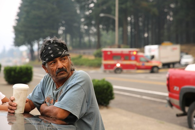 Rudy, who sells fish at the farmer's market in Cascade Locks, said Labor Day is normally the busiest day of the year for his business. But with the Eagle Creek Fire threatening the town, the market sat mostly empty Monday, Sept. 4, 2017.