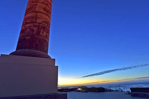 The Astoria Column illuminated in pink light in October for Breast Cancer Awareness Month.