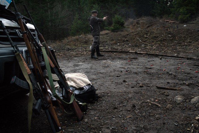 Ross Eliot, an activist and proponent of armed self-defense, fires a handgun on Feb. 2, 2019 in Hood River, Ore.