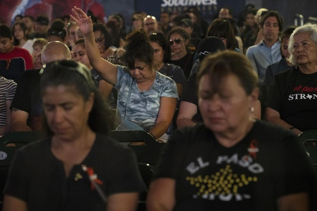 EL PASO, TX - AUGUST 14: People pray at the end of a memorial for the 22 people killed in a mass shooting on August 14, 2019 in El Paso, Texas.