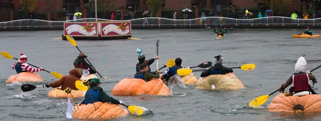 People compete in the 2017 West Coast Giant Pumpkin Regatta.