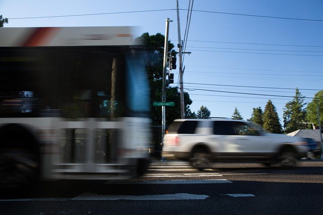 Cars and a TriMet bus drive down Southeast Division Street at 157th Avenue in Portland, Oregon, Wednesday, July 11, 2018.