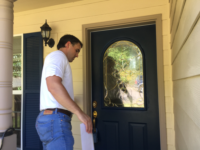 Ben Straka with the Freedom Foundation knocks on doors as part of the group's canvassing efforts. The foundation is urging public employees to opt out of paying union dues.