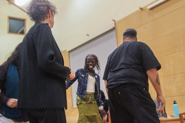 Portland City Council candidate Jo Ann Hardesty leads the crowd in a group dance at a candidates debate for the arts on Oct. 1, 2018.