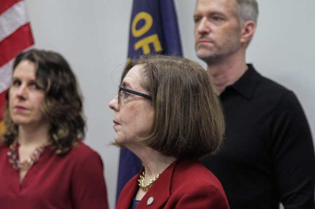 Local and state leaders, including Oregon Gov. Kate Brown, Portland Mayor Ted Wheeler and Multnomah County Chair Deborah Kafoury, gather at a news conference Thursday, March 12, 2020, to discuss statewide efforts to stem the spread of novel coronavirus.