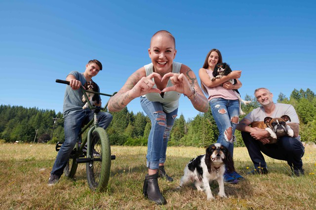 "Family portrait of Beast, Amanda, Jade and Gary with their dogs. Amanda Giese is the star of the new Animal Planet docu-show, ""Amanda to the Rescue."""