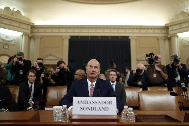 U.S. Ambassador to the European Union Gordon Sondland arrives to testify before the House Intelligence Committee on Capitol Hill in Washington, Wednesday, Nov. 20, 2019, during a public impeachment hearing of President Donald Trump's efforts to tie U.S. aid for Ukraine to investigations of his political opponents.