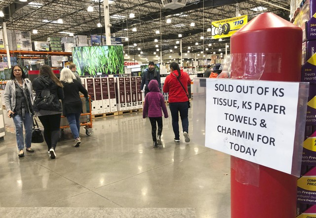 Shoppers visit a Costco Wholesale in Tigard, Ore., Saturday, Feb. 29, 2020, after reports of Oregon's first case of coronavirus was announced in the nearby Oregon city of Lake Oswego on Friday. (AP Photo/Gillian Flaccus)