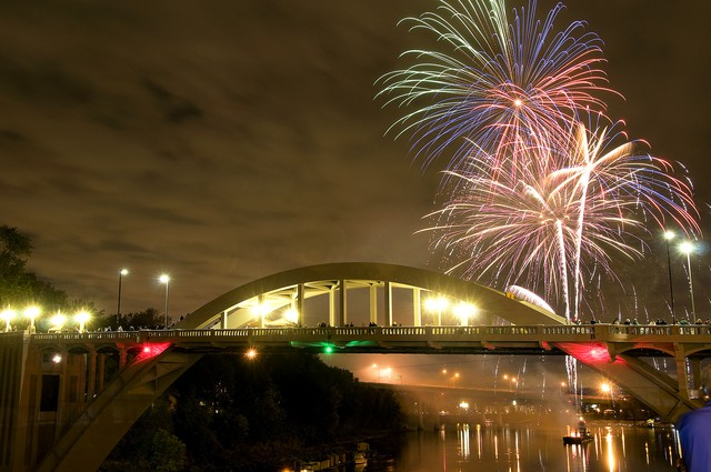 Fireworks light up the sky over the Oregon City Arch Bridge.
