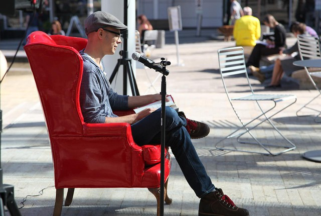 """Author Daniel H. Wilson reads from his book """"Robopocalypse"""" at a Red Chair reading in Directors Park."""