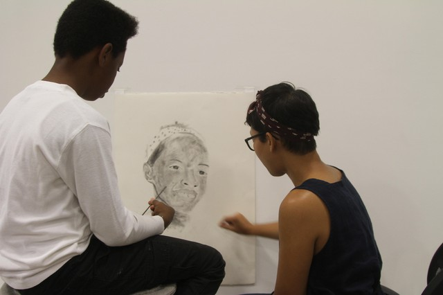 Student Michael Esperanza of Martin Luther King Jr. School works with artist Samantha Wall.