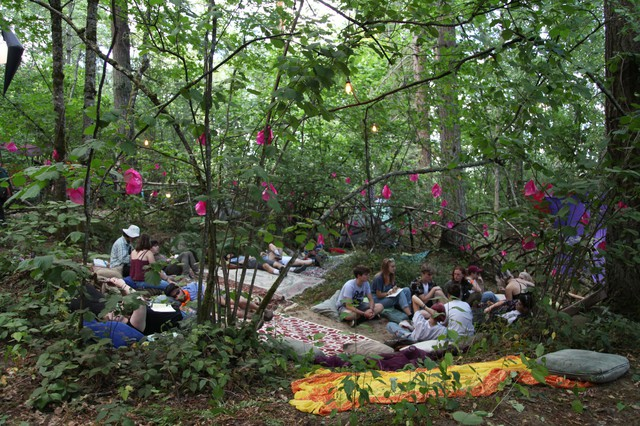 Festivalgoers take a breather at a common campground.