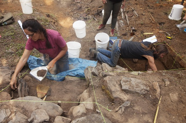 Archaeologists excavate the hearth from a Chinese gold miners' cabin in the Malheur National Forest.