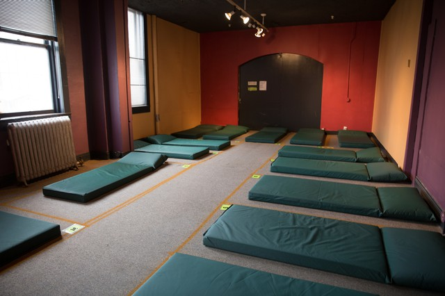 A room filledwith sleeping matsat the new temporary location of the Columbia Shelteron SE Grand Ave.