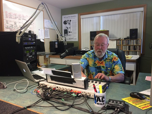 Ken Cartwright prepares to go on the air at KYAC in Mill City.