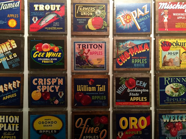 Old Central Washington apple labels hang in the Wenatchee Valley Museum & Cultural Center. The Apple industry is a crucial part of life in Central and Eastern Washington, and many feared an overreaction to lead and arsenic contamination would hurt apple growers.