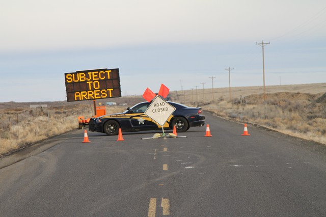 Police stand guard at the access road to the Malheur National Wildlife Refuge, Feb. 5.