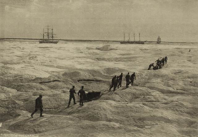 Members of a rescue crew hauling supplies to ice-bound whaling ships.