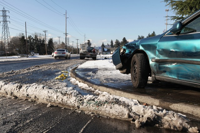 Roads remained closed and vehicles still littered the streets, Friday, Dec. 16, 2016, two days after at storm dumped snow on streets around the Portland area.