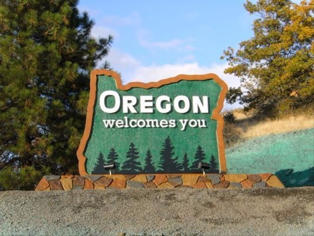 A welcome sign greets visitors along the southern Oregon border.
