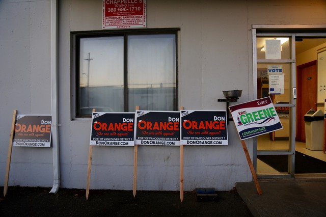 Campaign signs for Port of Vancouver Commissioner race outside the ILWU building in downtown Vancouver.