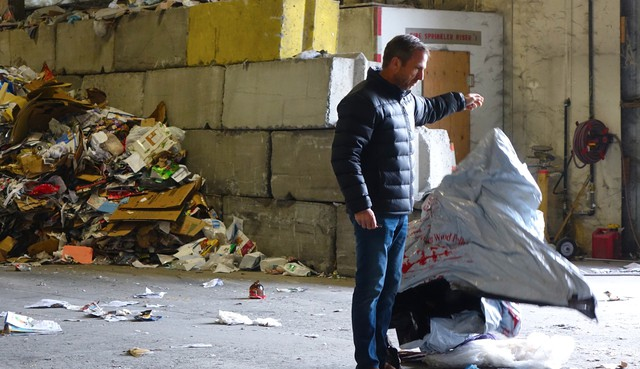 Rogue Waste System's Scott Fowler pulls non-recyclable trash out of the co-mingled recycling mix.